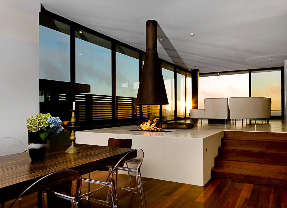 Photograph of modern interior design with fireplace and hard wood floors
