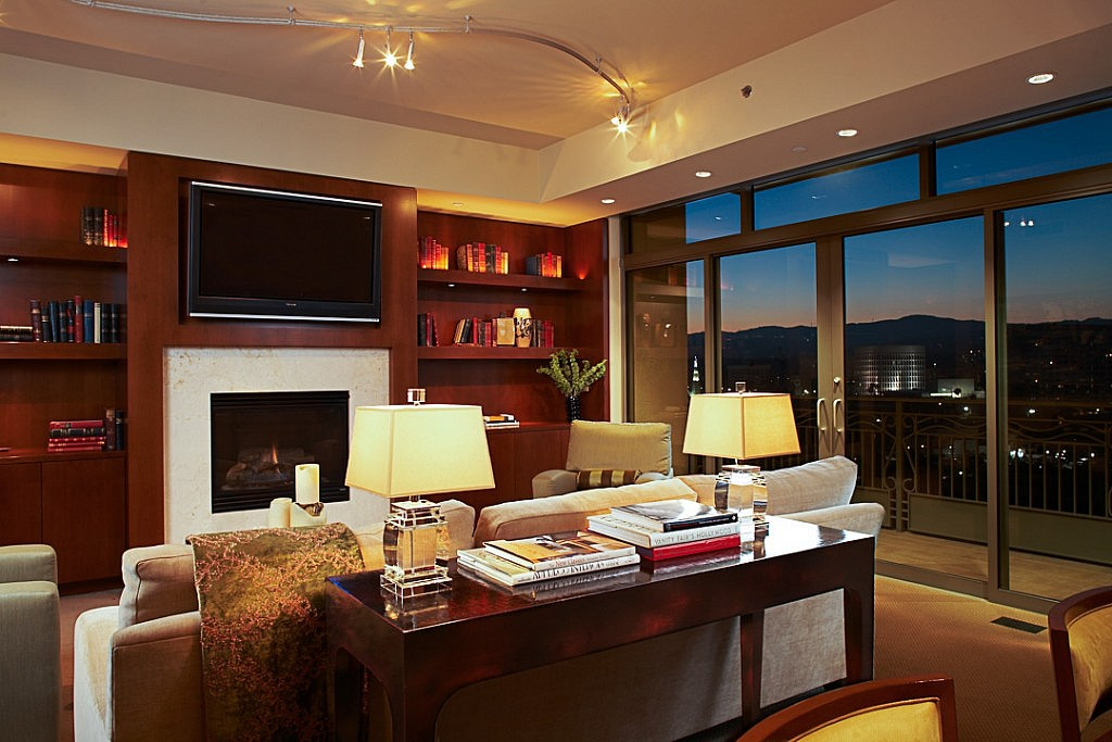 Photograph of high-rise living room with a view of Westwood at dusk