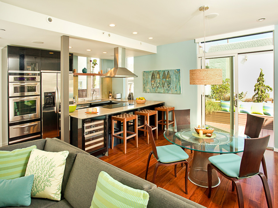 photograph of bright interior with kitchen and living room